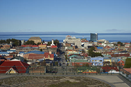 strait of magellan: PUNTA ARENAS, CHILE - AUGUST 25, 2016: Colourful rooftops of Punta Arenas in southern Chile overlooking the Strait of Magellan.