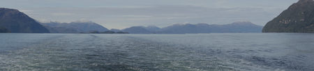 patagonian: Panorama of the wake of a ship passing through the Patagonian Channels of southern Chile Stock Photo