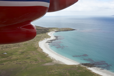 clear waters: Aircraft flying over beautiful white sandy beaches and clear blue waters of the Falkland Islands in the South Atlantic