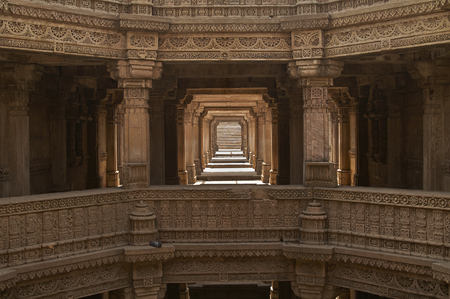 step well: Ornately carved stonework of the Adalaj Stepwell on the outskirts of Ahmadabad, Gujarat, India. Built circa 1499.