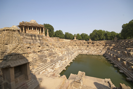 temple tank: Ancient stepped water tank in front of the Sun Temple at Modhera. Ancient Hindu temple built circa 1027. Gujarat, India.