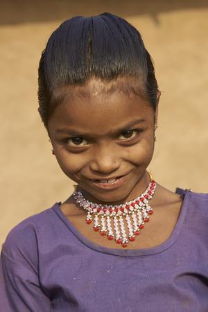 madhya: MANDU, MADHYA PRADESH, INDIA - NOVEMBER 19, 2008: Portrait of a young girl in the rural hilltop fortress of Mandu in Madhya Pradesh, India