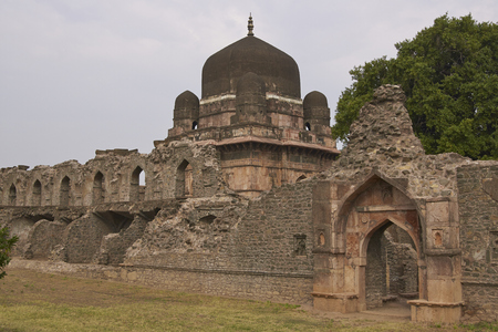 Darya Khans tomb in the hilltop fortress of Mandu. Building with central dome and a smaller dome on each corner in a walled compound. 16th Century AD