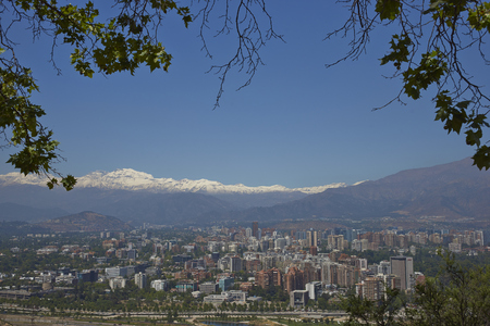 cristobal: SANTIAGO, CHILE - DECEMBER 27, 2016: View of the Santiago, capital of Chile, from Cerro San Cristobal.  Densely packed modern buildings backed by the snow capped mountains of the Andes.