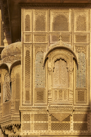 Delicate carved stone walls and window surrounds of a wealthy merchants Haveli in the historic quarter of Jaisalmer in Rajasthan India Stock Photo