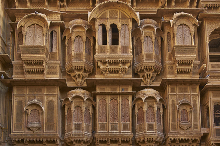 Detail of ornate window screens adorning the Patwon Haveli, a historoc merchants house, in the old town of Jaisalmer in Rajasthan, India. Stock Photo
