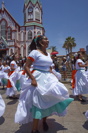 ARICA, CHILE - FEBRUARY 10, 2017: Female members of an ethnic dance group comprising of people of African descent, dancing as part of the parade at the annual Carnaval Andino con la Fuerza del Sol.