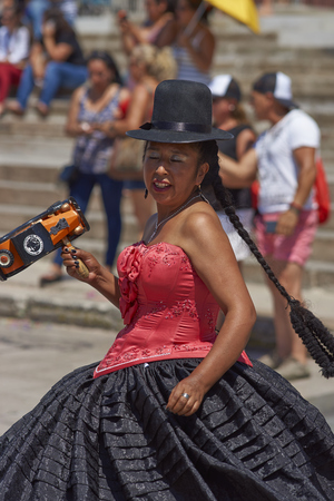 ARICA, CHILE - FEBRUARY 10, 2017: Female members of a Morenada Dance Group dressed in ornate costumes performing during a street parade at the annual Carnaval Andino con la Fuerza del Sol in Arica