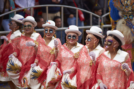 bolivian: ORURO, BOLIVIA - FEBRUARY 25, 2017: Morenada dancers in ornate costumes parade through the mining city of Oruro on the Altiplano of Bolivia during the annual carnival. Editorial