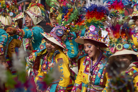 designated: ORURO, BOLIVIA - FEBRUARY 25, 2017: Tinkus dancers in colourful costumes performing at the annual Oruro Carnival. The event is designated by UNESCO as being Intangible Cultural Heritage of Humanity.