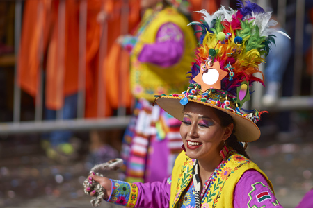 fiesta popular: ORURO, BOLIVIA - FEBRUARY 25, 2017: Tinkus dancer in colourful costume performing at the annual Oruro Carnival. The event is designated by UNESCO as being Intangible Cultural Heritage of Humanity. Editorial