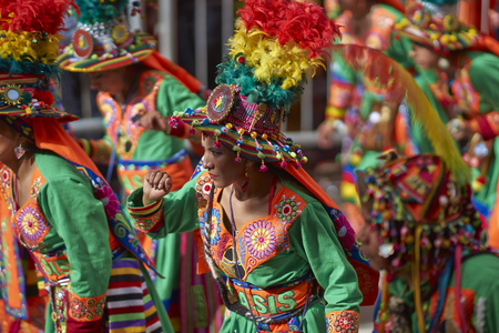 bolivian: ORURO, BOLIVIA - FEBRUARY 25, 2017: Tinkus dancers in colourful costumes performing at the annual Oruro Carnival. The event is designated by UNESCO as being Intangible Cultural Heritage of Humanity.