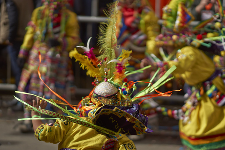 fiesta popular: ORURO, BOLIVIA - FEBRUARY 25, 2017: Tinkus dancers in colourful costumes performing at the annual Oruro Carnival. The event is designated by UNESCO as being Intangible Cultural Heritage of Humanity.