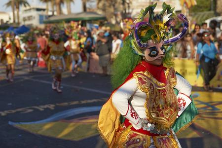 chilean: ARICA, CHILE - FEBRUARY 10, 2017:Masked Diablada dancer in ornate costume performing at the annual Carnaval Andino con la Fuerza del Sol in Arica, Chile Editorial