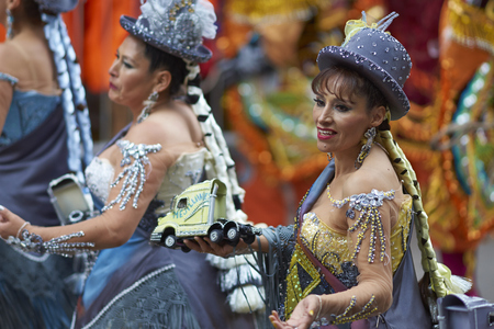 ORURO, BOLIVIA - FEBRUARY 25, 2017: Morenada dancers in ornate costumes parading through the mining city of Oruro on the Altiplano of Bolivia during the annual carnival.
