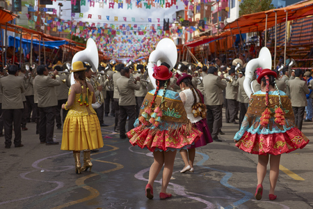 bolivian: ORURO, BOLIVIA - FEBRUARY 26, 2017: Morenada dance group in colourful outfits parading through the mining city of Oruro on the Altiplano of Bolivia during the annual Oruro Carnival. Editorial