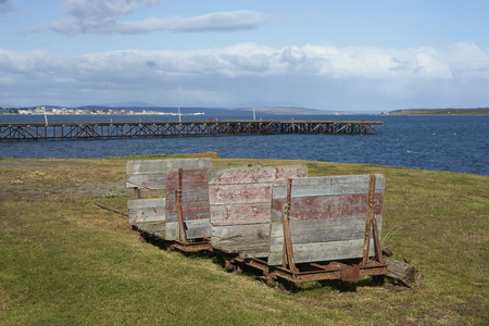 singular architecture: PUERTO NATALES, CHILE - APRIL 10, 2017: Historic railway cart at a former meat refrigeration plant that have been renovated and converted into a luxury hotel. Stock Photo