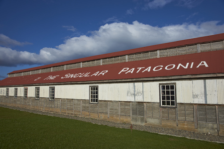 singular architecture: PUERTO NATALES, CHILE - APRIL 10, 2017: Historic buildings of a former meat refrigeration plant that have been renovated and converted into a luxury hotel.