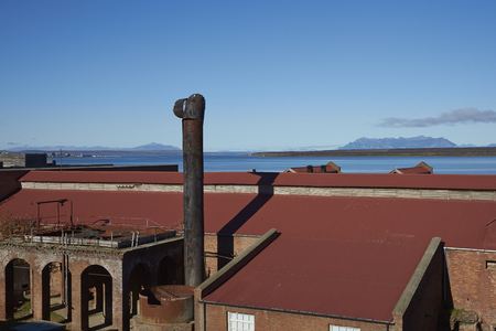 singular architecture: PUERTO NATALES, CHILE - APRIL 15, 2017: Historic buildings of a former meat refrigeration plant that have been renovated and converted into a luxury hotel.