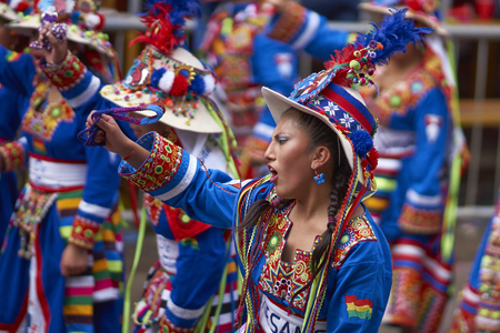 bolivian: ORURO, BOLIVIA - FEBRUARY 26, 2017: Tinkus dance group in ornate costumes performing as they parade through the mining city of Oruro on the Altiplano of Bolivia during the annual carnival.