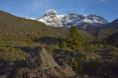 Mountain Sierra Velluda (3,585 m) rising above forested hillsides in Laguna de Laja National Park in the Bio Bio region of Chile.
