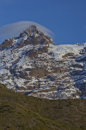 Hanging glaciers flowing down from the mountain Sierra Velluda (3,585 m) in Laguna de Laja National Park in the Bio Bio region of Chile. Stock Photo