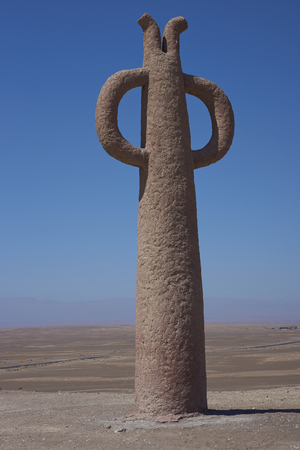 Arica, Chile - August 21, 2017: Sculptures known as Presencias Tutelares, in the Atacama Desert alongside the Pan American Highway near Arica in northern Chile. Stock Photo