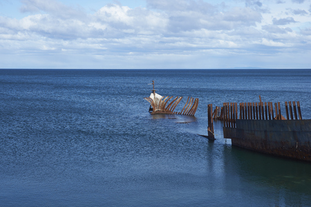 Rusting wreck of the ship Lord Lonsdale on the coast of the Strait of Magellan at Punta Arenas, Chile. Stock Photo