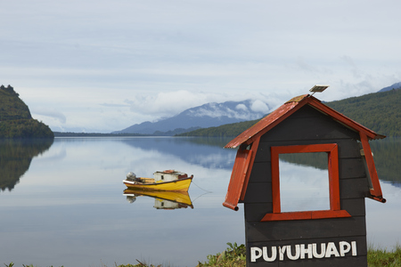 Puyuhuapi, Ays�n Region, Chile - November 12, 2017: Small boat moored on the still waters of a sea loch at Puyuhuapi, a small town on the Carretera Austral in northern Patagonia, Chile.