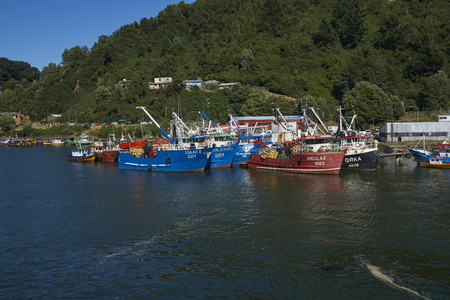Valdivia, Los Lagos, Chile - January 31, 2018: Fishing boats alongside on the banks of the Valdivia River downstream of the city of Valdivia in southern Chile.