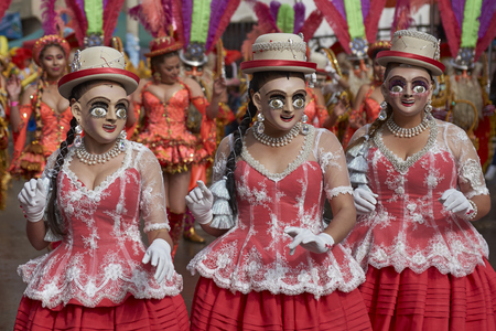 ORURO, BOLIVIA - FEBRUARY 25, 2017: Morenada dancers in ornate costumes parade through the mining city of Oruro on the Altiplano of Bolivia during the annual carnival. Publikacyjne