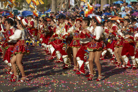 ARICA, CHILE - JANUARY 23, 2016: Caporales dance group in ornate red and white costume performing at the annual Carnaval Andino con la Fuerza del Sol in Arica, Chile.