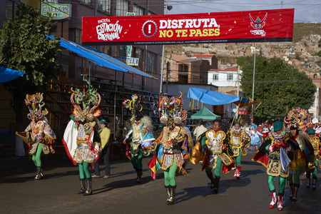 ORURO, BOLIVIA - FEBRUARY 26, 2017: Diablada dancers in ornate costumes prepare to parade through the mining city of Oruro on the Altiplano of Bolivia during the annual carnival.