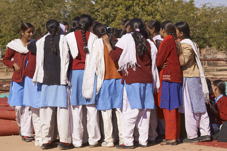 Nagaur, Rajasthan, India - February 14, 2008: Group of school girls find something interesting at the annual livestock festival in Nagaur, Rajasthan, India. Editorial
