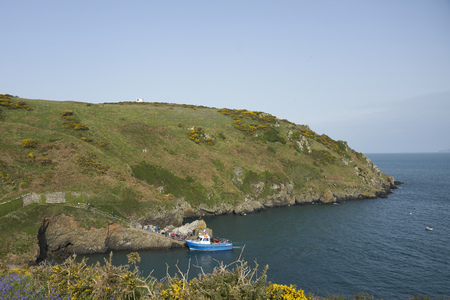 Martins Haven, Pembrokeshire, Wales - April 23, 2019: Boat taking visitors to the Island of Skomer off the coast of Pembrokeshire in Wales, United Kingdom.