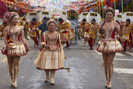 ORURO, BOLIVIA - FEBRUARY 26, 2017: Morenada dancers in ornate costumes parading through the mining city of Oruro on the Altiplano of Bolivia during the annual carnival.