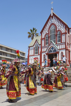 ARICA, CHILE - FEBRUARY 10, 2017: Men and women of the group Thinkus Rupay Masis, performing at the annual street carnival celebrating the strength of the sun.