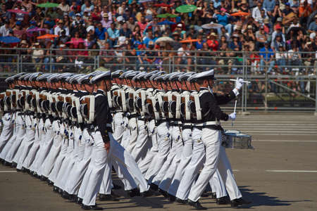 SANTIAGO, CHILE - SEPTEMBER 19, 2016: Members of the Armada de Chile march past during the annual military parade as part of the Fiestas Patrias commemorations in Santiago, Chile. Editorial