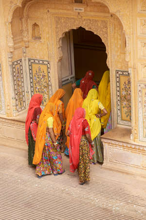 JAIPUR, RAJASTHAN, INDIA - JULY 30, 2008: Group of Indian women in brightly coloured saris in a Rajput palace inside Nahargarh Fort overlooking Jaipur in Rajasthan, India