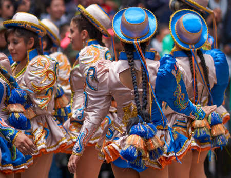 ORURO, BOLIVIA - FEBRUARY 25, 2017: Caporales dancers in ornate costumes performing as they parade through the mining city of Oruro on the Altiplano of Bolivia during the annual carnival. Publikacyjne