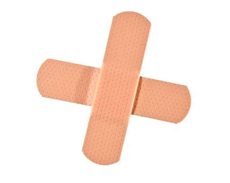 Adhesive first aid bandages placed in a cross