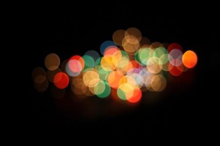 ライト ショット故意に焦点が合っていません。できるレンズとして yse のフレア。休日やお祭りの背景の偉大な使用は! 写真素材