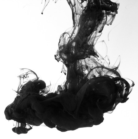 ink in water: Indian ink in water with a white back ground.