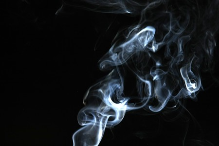 black and white photography: Smoke with a black background. Abstract element to help your design
