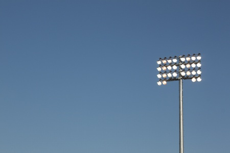 Stadium lights on a blue sky background. could be used for football, soccer, baseball, etc.