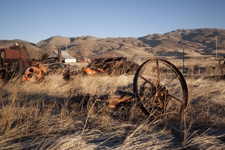 old rusty farm equipment in the middle of a field