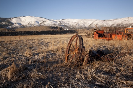 farm equipment: old rusty farm equipment in the middle of a field