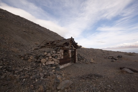 A old abandoned cabin in the desert. scenic house travel shack solitude photo