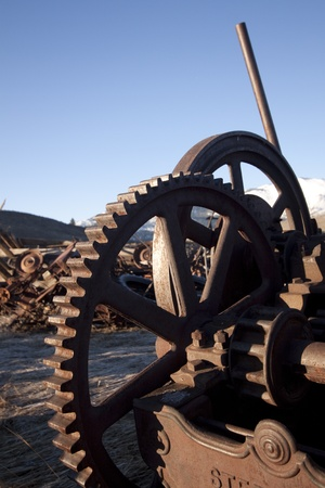 old rusty farm equipment in the middle of a field Stock Photo - 9892695