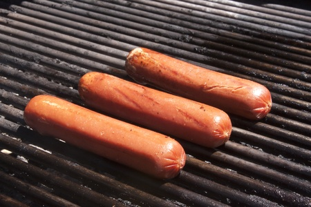 Hot dogs on a bbq photo